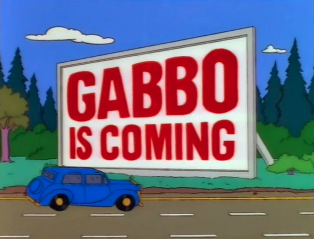 Mr Burn's car drives past a Gabbo billboard - The Simpsons, Krusty Gets Kancelled